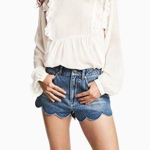 High-waisted scalloped-hem denim shorts